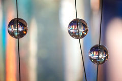 Glass spheres as a design elements. Abstract background with glass spherical design elements of modern chandelier Stock Photo