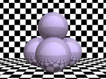 Glass spheres on checkerboard Stock Image