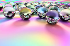 Glass Spheres on Colorful Surface Stock Images