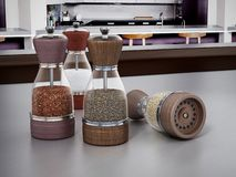 Glass spice grinders set standing on kitchen table. 3D illustration.  stock illustration