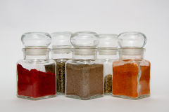 Glass spice jars Stock Images