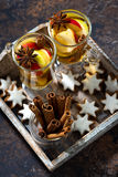 glass of spiced hot apple tea and gingerbread cookies Stock Photos