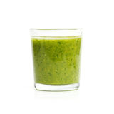 Glass with spinach, herbs, mint, kiwi and banana smoothie Royalty Free Stock Images