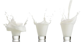 Glass of splashing milk isolated on white background Stock Photo