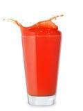 Glass of splashing tomato juice. Isolated on white. Tomato splash Stock Photos
