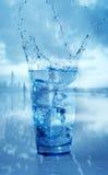 Glass with splashing water Stock Image