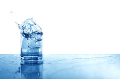 Glass Of Splashing Water Royalty Free Stock Photo