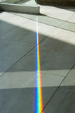 A glass spliting sunlight into spectrum colors Royalty Free Stock Photos