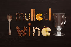 Glass and spoon and text mulled wine made from slice of orange, Stock Photo