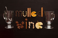 Glass and spoon and text mulled wine made from slice of orange, Stock Photography