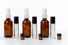 Glass Spray and Roller Sample Bottles on White Background Royalty Free Stock Photo
