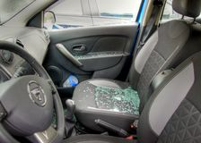 Glass is spread all over the car seats after a robery Royalty Free Stock Photography