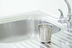 Glass stainless put on the sink. Interior Royalty Free Stock Image