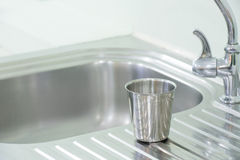 Glass stainless put on the sink. Interior Stock Photography