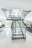 Glass stairs in modern house Royalty Free Stock Photography