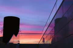 Glass stairs next to colorful sunset sunrise sky royalty free stock images