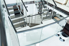Glass stairs in the residence. Glass stairs in the modern residence Royalty Free Stock Photos