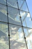 Glass stairway. Stairway behind glass with reflection of the blue sky and clouds Royalty Free Stock Photo