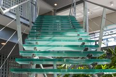 Glass stairway in a modern office building. Green glass stairway in a modern office building Royalty Free Stock Photography