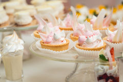 Glass stand with cupcakes on a wedding candy bar table Stock Photography