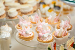 Glass stand with cupcakes on a wedding candy bar table Royalty Free Stock Image