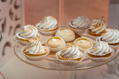 Glass stand with cupcakes on a wedding candy bar table Stock Photos