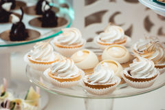 Glass stand with cupcakes on a wedding candy bar table Stock Image