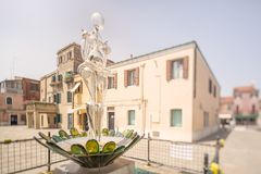 Glass statueof woman on Murano or Burano island. In Venice, Italy Royalty Free Stock Images