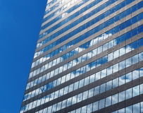 Glass And Steel Building With Clouds Royalty Free Stock Photos