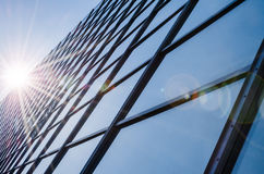 Glass and steel - mirrored facade of modern office building stock photography