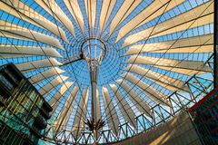 Glass and steel roof of Sony Centre in Berlin. BERLIN, GERMANY - June 9, 2018: Spectacular roof of the Sony Center, a Sony-sponsored building complex located at Stock Image