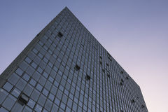 Glass and steel skyscraper, cloudless afternoon sky Stock Image