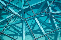 Glass and steel wall. Glass panels with steel framing of interlocking triangles stock photography