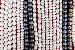 Glass and stone beads on the market Stock Image