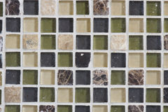 Glass and Stone Tiles. The pattern made by these glass and stone tiles make a good back splash behind a kitchen sink Stock Photography