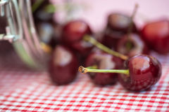 Glass storage jar full of fresh cherries Royalty Free Stock Photography