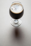 Glass of stout Stock Images