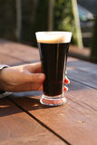 Glass of stout, summer evening Royalty Free Stock Photos