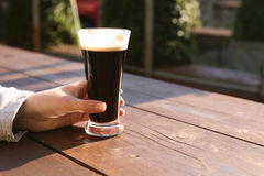 Glass of stout, summer evening Stock Photography