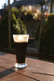 Glass of stout, summer evening Stock Images