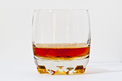 Glass of straight bourbon whiskey. Royalty Free Stock Images