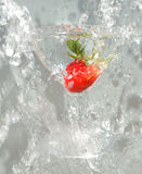 Glass and strawberry 2. Glass splashing into water with a strawberry stock photos