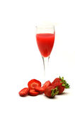 Glass of strawberry juice. With whole and sliced strawberries Stock Photo