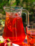 Glass with strawberry juice and berrie. S on blur background royalty free stock photography