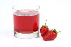 Glass with strawberry juice and berries Royalty Free Stock Photos