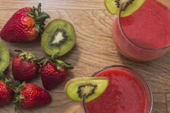Glass of strawberry juice with kiwi Royalty Free Stock Images