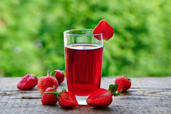 A glass of strawberry juice Royalty Free Stock Images