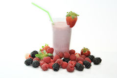 Glass of strawberry milkshake stock images