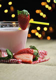 Glass of strawberry milkshake Stock Photography