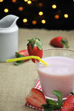 Glass of strawberry milkshake Stock Photo